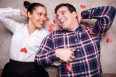 Happy couple lying on the floor Royalty Free Stock Image