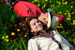 Happy couple lying on a grass Royalty Free Stock Photography