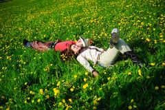 Happy couple lying on a grass Royalty Free Stock Photos