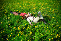 Happy couple lying on a grass Royalty Free Stock Images