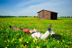 Happy couple lying on a grass Royalty Free Stock Image