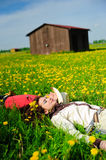 Happy couple lying on a grass Stock Images