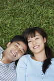 Happy Couple Lying On Grass Stock Photos