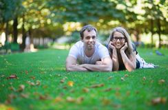 Happy couple lying on the grass Stock Photography