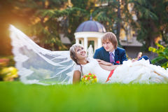 Happy couple are lying on the green grass Royalty Free Stock Photo