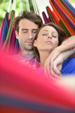 Happy couple lying in hammock Royalty Free Stock Photo