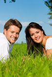 Happy couple lying on a meadow Royalty Free Stock Photography