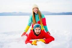 Happy couple lying in snow Stock Image