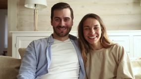 Happy couple make videocall wave hands chatting with friends. Happy couple make videocall webcam view looking at camera wave hands greeting keep in touch with stock video footage