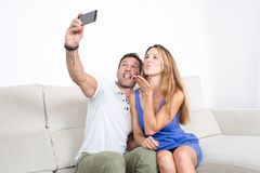 Happy couple makes a selfie with a phone Royalty Free Stock Image