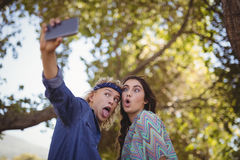 Happy couple making faces while taking selfie Royalty Free Stock Photos