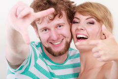 Happy couple making frame with hands Royalty Free Stock Image