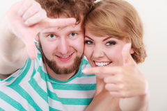 Happy couple making frame with hands Royalty Free Stock Images