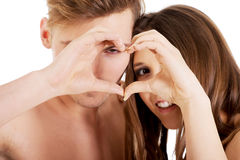 Happy couple making heart with fingers. Stock Image