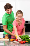 Happy couple making a meal Stock Images