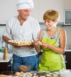 Happy couple making meat dumplings Royalty Free Stock Images