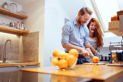 Happy couple making organic juice Stock Image
