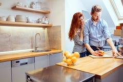 Happy couple making organic juice Stock Photography