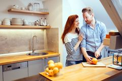 Happy couple making organic juice in kitchen stock photos
