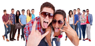 Happy couple making the rock and roll gesture Royalty Free Stock Photo