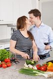Happy couple making a salad Stock Image