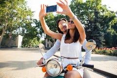 Happy couple making selfie photo on smartphone Stock Photos
