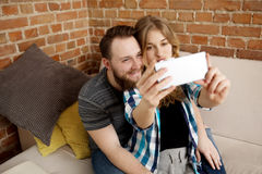 Happy couple making selfie. Royalty Free Stock Photos