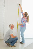 Happy couple making some measurements together Stock Photos