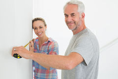 Happy couple making some measurements together Stock Photo