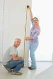 Happy couple making some measurements together Royalty Free Stock Photography