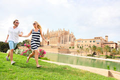Happy couple on Mallorca, La Seu, Palma Cathedral. Happy couple on Mallorca in front of La Seu, Palma Cathedral. Travel couple on Majorca vacation holiday Stock Photos