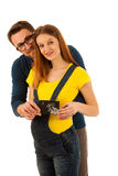 Happy couple man and beautiful pregnant woman show with ultrasou Stock Photo