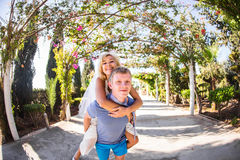 Happy couple. Man carrying woman on his back Royalty Free Stock Photo