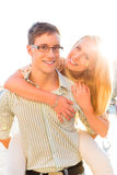 Happy couple - man carrying woman piggyback Royalty Free Stock Image