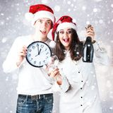 Happy couple man and fat woman celebrate Christmas and new year. Royalty Free Stock Photography