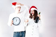 Happy couple man and fat woman celebrate Christmas and new year. Stock Photos