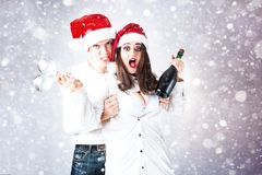 Happy couple man and fat woman celebrate Christmas and new year. Stock Photography