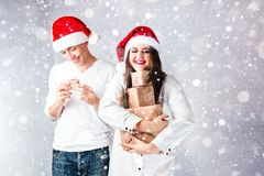 Happy couple man and fat woman celebrate Christmas and new year. Happy couple men and fat women celebrate Christmas and new year. Man and women model plus size Royalty Free Stock Images