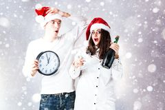 Happy couple man and fat woman celebrate Christmas and new year. Royalty Free Stock Image