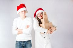 Happy couple man and fat woman celebrate Christmas and new year. Happy couple men and fat women celebrate Christmas and new year. Man and women model plus size Stock Images