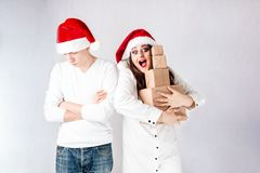Happy couple man and fat woman celebrate Christmas and new year. Happy couple men and fat women celebrate Christmas and new year. Man and women model plus size Stock Image
