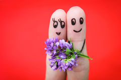 Happy couple. Man is giving flowers to a woman.  Royalty Free Stock Images