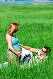 Happy couple man and pregnant girl Royalty Free Stock Photos