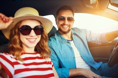 Happy couple man and woman in car traveling in summer stock images