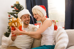 Happy couple man and woman celebrating New Year Stock Images