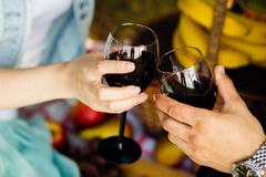 Happy couple - man and woman drinking wine Stock Photography