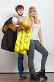 Happy couple man and woman with fashion jackets. Royalty Free Stock Photo