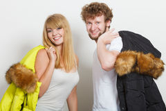 Happy couple man and woman with fashion jackets. Stock Photos