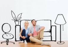 Happy couple of man and woman moving to new home Royalty Free Stock Images