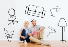 Happy couple of man and woman moving to new home Royalty Free Stock Photo